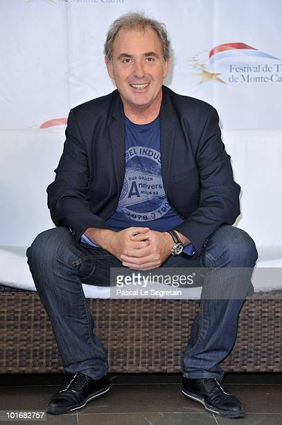 French TV presenter Philippe Risoli poses at a photocall for the French TV show 'L'Ecole des Fans' during the 2010 Monte Carlo Television Festival...