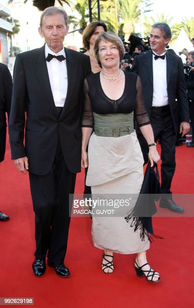 French tv TF1 vicechairman Etienne Mougeotte and his wife arrive at the Festival Palace to attend the premiere of French director Xavier Giannoli's...