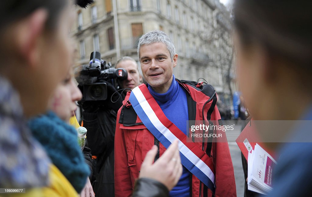 French UMP opposition right-wing party member Laurent Wauquiez (C) takes part in a march against same-sex marriage on January 13, 2013 in Paris. Tens of thousands march in Paris on January 13 to denounce government plans to legalise same-sex marriage and adoption which have angered many Catholics and Muslims, France's two main faiths, as well as the right-wing opposition. The French parliament is to debate the bill -- one of the key electoral pledges of Socialist President -- at the end of this month.