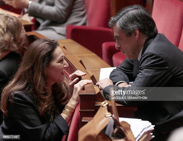 French UMP rightwing party's deputy and former French Prime Minister Francois Fillon speaks with French UMP deputy Valerie Boyer during a session of...