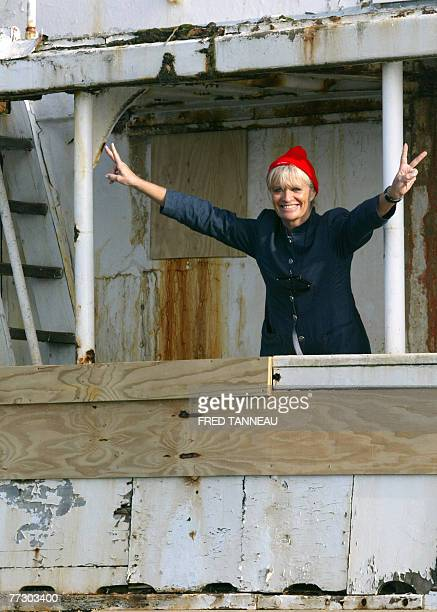 French undersea explorer Jacques Cousteau's widow Francine Cousteau waves on board The Calypso upon the arrival of the research ship to be restaured...