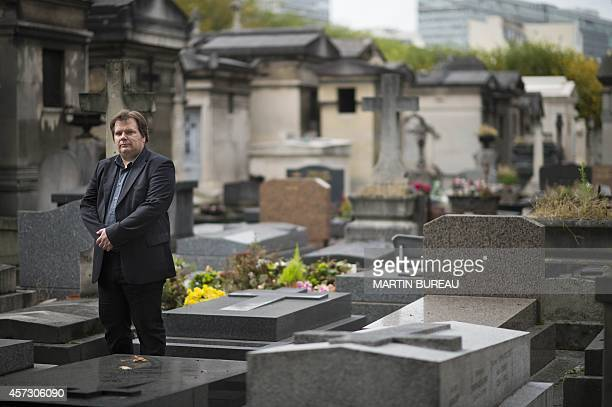 French undertaker and writer Guillaume Bailly poses at the Montparnasse cemetery on October 16 2014 in Paris MARTIN BUREAU