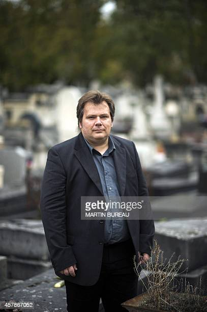 French undertaker and writer Guillaume Bailly poses at the Montparnasse cemetery on October 16 2014 in Paris AFP PHOTO / MARTIN BUREAU
