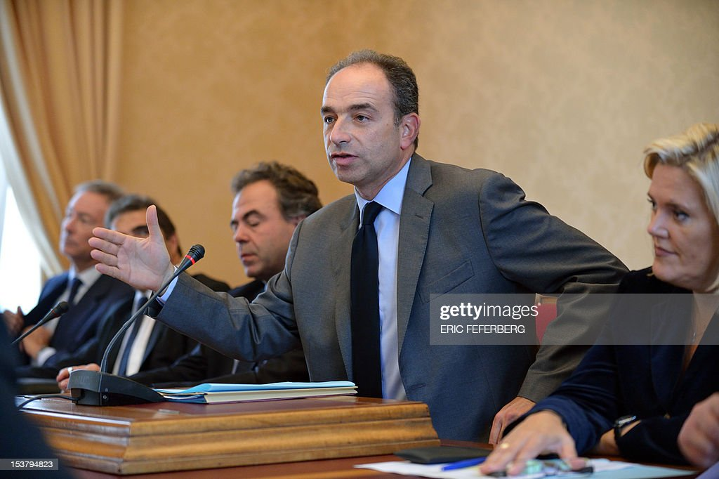 French Union for a Popular Movement (UMP) right-wing opposition party's general secretary and candidate for his own succession Jean-Francois Cope flanked by his team campaign, Michèle Tabarot (R), Luc Chatel (3rdL), Christian Jacob (2ndL) and Bernard Deflessel (L) speaks during a meeting with MP at the French National Assembly in Paris, on October 9, 2012.