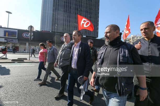 French union Force Ouvriere Confederal Secretary Pascal Pavageau takes part in a rally called by several French workers unions on October 9 2018 in...