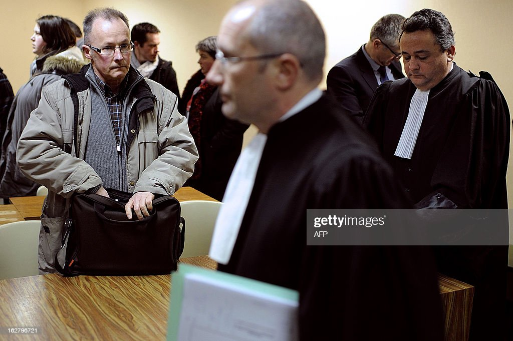 French unions representative of the Gad SAS agribusiness company's pig-slaughterhouse, Patrick Piguel (L), arrives for an audience at the trade tribunal on February 27, 2013 in Rennes, western France, some days after the voluntary liquidation by the group. Gad SAS which employs 1,700 workers in two sites, Josselin and Lampaul-Guimiliau, lost 20 million euros (26,15 million US dollars) in 2012.