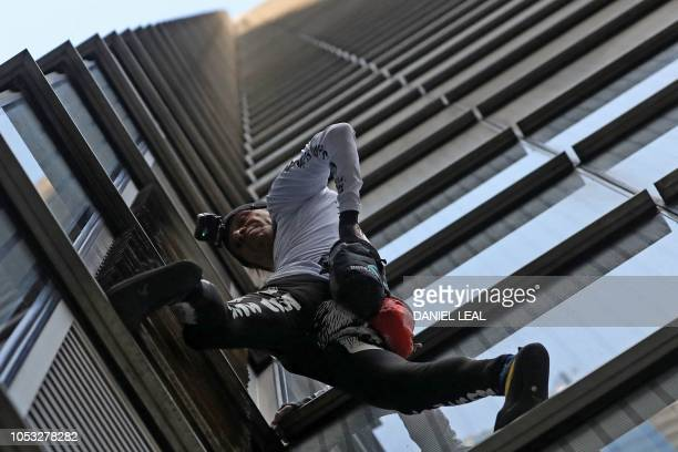 French urban climber Alain Robert also known as 'SpiderMan' begins his climb of Heron Tower 110 Bishopsgate in central London on October 25 the...