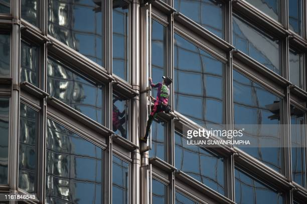TOPSHOT French urban climber Alain Robert popularly known as the French Spiderman climbs the Cheung Kong Center building in Hong Kong on August 16...