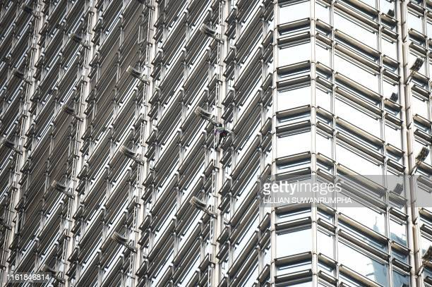 French urban climber Alain Robert popularly known as the French Spiderman climbs the Cheung Kong Center building in Hong Kong on August 16 2019...