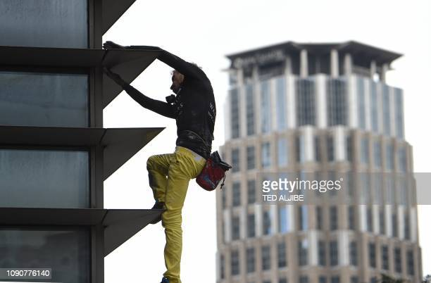 French urban freeclimber Alain Robert popularly known as the French Spiderman is pictured on the side of the 47storey GT Tower in Manila's financial...