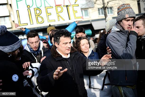 French urgentist and contributor to French satirical magazine Charlie Hebdo Patrick Pelloux speaks to people on January 23 2015 outside the Hyper...