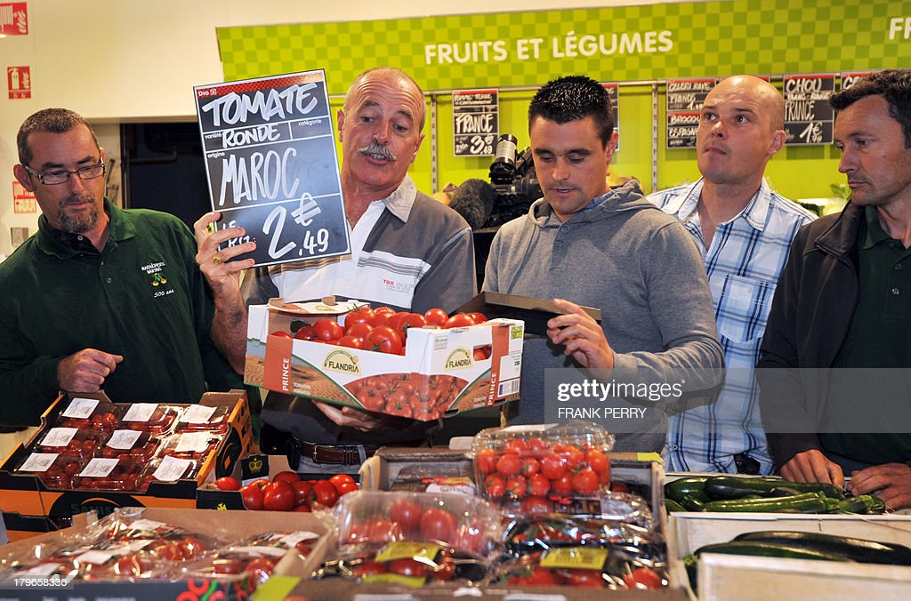 French vegetable producers protest against the sale of vegetables imported from other countries in a Dia discount store in Sainte-Luce-sur-Loire on September 6, 2013.
