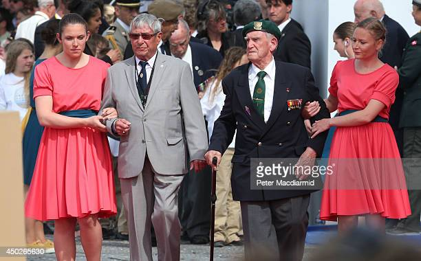 French veteran Leon Gautier and German paratrooper Johannes Borner the stage during the International Ceremony at Sword Beach to commemorate the 70th...