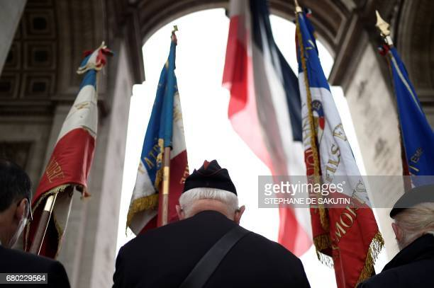 French veterans attend the ceremony marking the 72nd anniversary of the victory over Nazi Germany during WWII on May 8 1945 under the Arc de Triomphe...