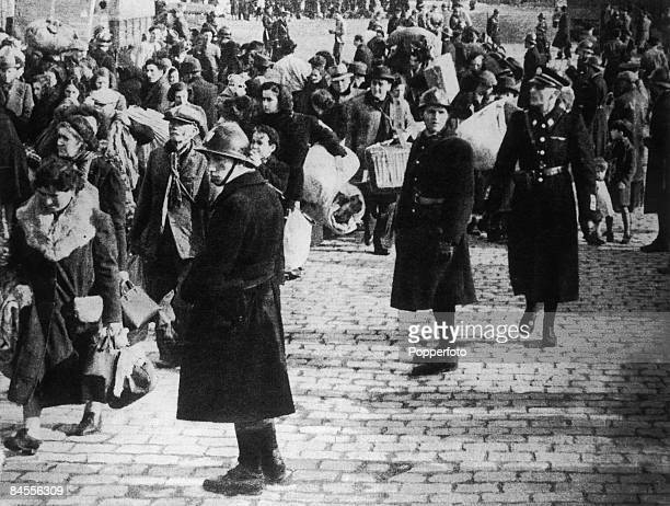 French Vichy troops and German SS officers oversee the compulsory evacuation of 40, 000 people from the old port quarter of Marseille, France, 19th...