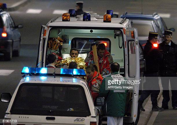 French victim of the 26 December tsunamis that hit south Asia is taken away in an ambulance from Roissy airport north of Paris after being...