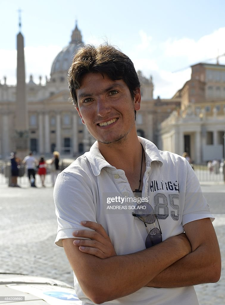 French Vincent Gelot, 26, poses on St. Peter's square, on August 26, 2014 at the Vatican. Vincent Gelot spent the past two years traveling around the world with his 4L car, visiting Christian communities in 23 countries and saving their testimonies in a large leather book which ends with a dedication by the Pope who wrote 'Thank you so much for this testimony of the Eastern Church, a church that has given so many saints and now suffer. I pray for you all, I am close to you.'