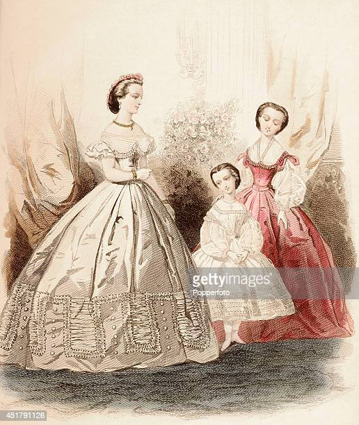 A French vintage fashion illustration featuring two stylish ladies and a young girl in a sumptuous interior published in Paris circa January 1862
