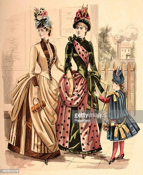 A French vintage fashion illustration featuring two stylish ladies and a young girl wearing day dresses and feathered hats at a railroad station...
