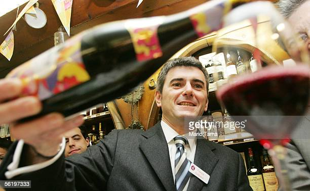 French vintner Franck Duboeuf pours a glass of Beaujolais Nouveau 2005 at SherryLehmann wine and spirits November 17 2005 in New York City Beaujolais...