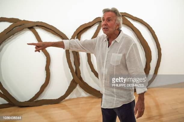 French visual artist Bernar Venet presents his works to the journalists during the press opening of his retrospective exhibition on September 20 2018...