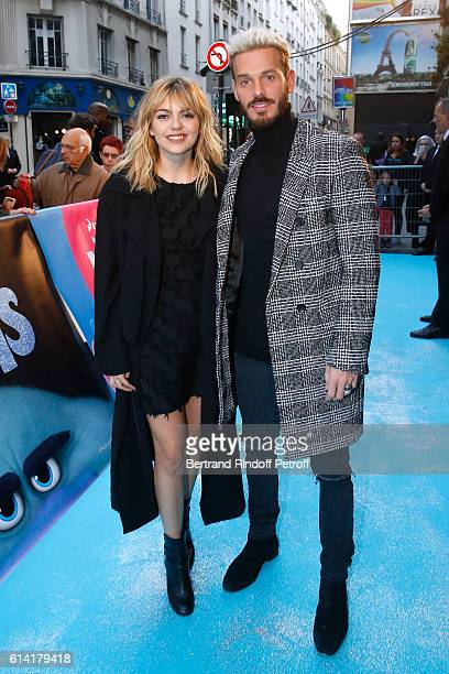 """French voices of the movie, Louane Emera and Matt Pokora attend """"Les Trolls"""" Paris Premiere at Le Grand Rex on October 12, 2016 in Paris, France."""