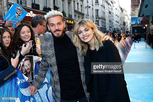 """French voices of the movie, Louane Emera and Matt Pokora, signing autographs, attend """"Les Trolls"""" Paris Premiere at Le Grand Rex on October 12, 2016..."""