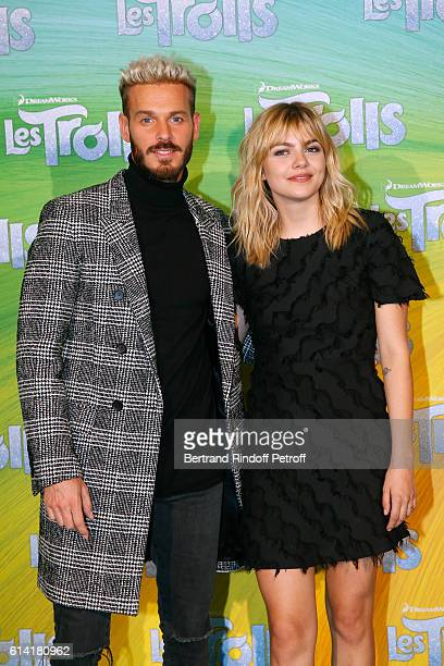 """French voices of the movie, Matt Pokora and Louane Emera attend """"Les Trolls"""" Paris Premiere at Le Grand Rex on October 12, 2016 in Paris, France."""