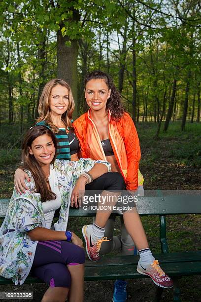 French weather presenters Tatiana Silva Cali Morales Laurence Roustandjee pose at the sport center of the Bois de Boulogne on April 25 2013 in...
