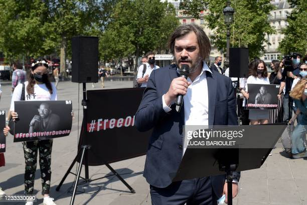 French weekly Le Point's director Etienne Gernelle delivers a speech in Paris on June 8, 2021 during a gathering for French journalist Olivier...