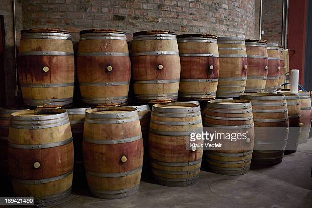 French wine barrels stacked at winery