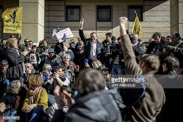 French winemaker Emmanuel Giboulot waves to his supporters before entering the court on February 24 2014 in Dijon eastern France Giboulot is pursued...