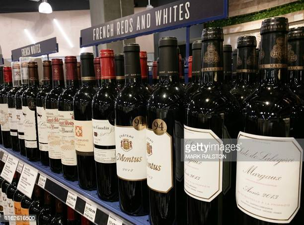 French wines are dislpayed for sale at a supermarket in Los Angeles, California on August 18, 2019. - President Donald Trump has floated the idea of...