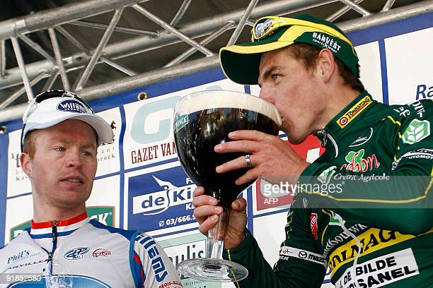 French winner Denis Flahaut celebrates while drinking a glass of beer as second placed Dutch Stefan Van Dijk looks on after taking part in the...