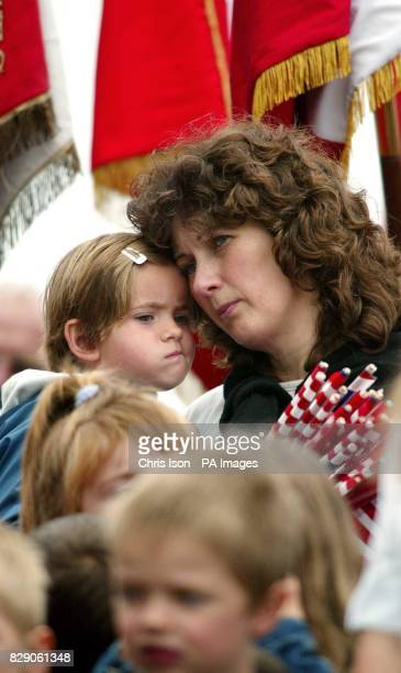 A French woman and her daughter from Magneville in Normandy at a memorial in their village to soldiers of the American 101st Airborne Division who...