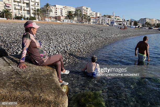A French woman named Dalila wears a burkini as she sunbathes on the beach of Carras in the city of Nice southeastern France on August 26 2016 Burkini...