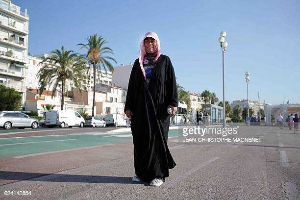 A French woman named Dalila wears a burkini as she swims and sunbathes on the beach of Carras in the city of Nice southeastern France on August 26...