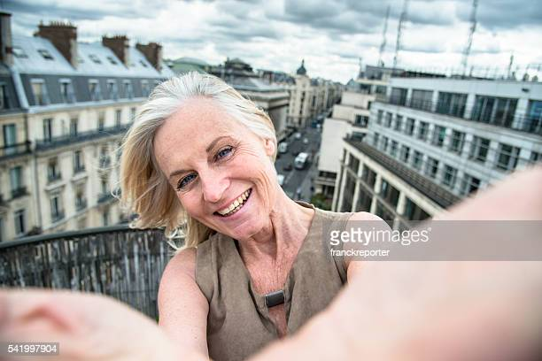 french woman take a selfie on the rooftop in paris