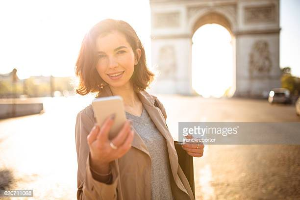 french woman with the smartphone in paris