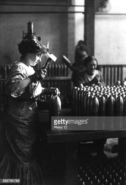French woman working in a bombmaking factory France World War I 19151916 Brussels War Museum