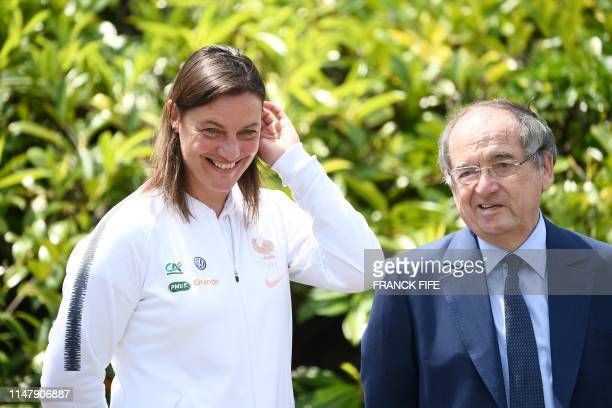 French women national football team headcoach Corinne Diacre talks to FFF president Noel le Graet in ClairefontaineenYvelines southwest of Paris on...