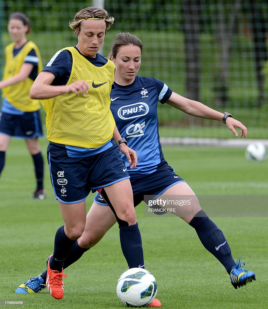 French women's national football team captain Sandrine Soubeyrand (L) vies with midfielder Gaetane Thiney during a training session on June 20, 2013 in Clairefontaine-en-Yvelines, outside Paris, ahead of the July 10 to 28 European Championship in Sweden.