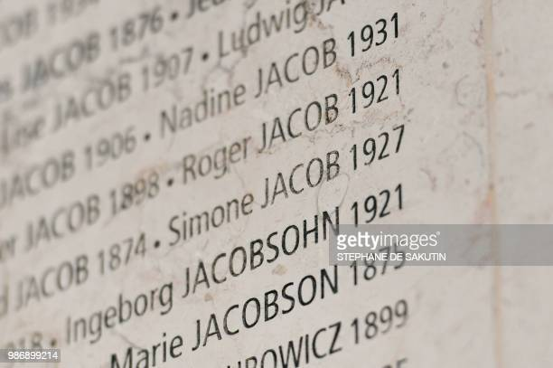 French women's rights icon politician and Holocaust survivor Simone Jacob is etched on the Wall of Names at the French Holocaust memorial in Paris...