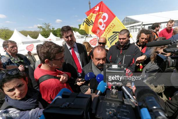 French workers union CGT general secretary Philippe Martinez speaks with the press during a gathering of employees of the stateowned rail operator...