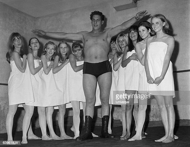 French wrestler Andre Rene Roussimoff best known as 'Andre the Giant' during a fashion exhibition At 19 Andre stands 7 feet and 4 inches tall