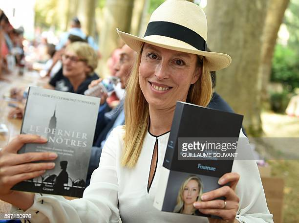 French writer Adelaide de Clermond Tonnerre poses with her books during the 21th book fair La Foret Des Livres on August 28 2016 in...