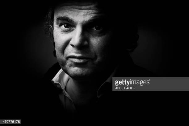French writer Alexandre Jardin poses on April 20 2015 in Paris AFP PHOTO / JOEL SAGET