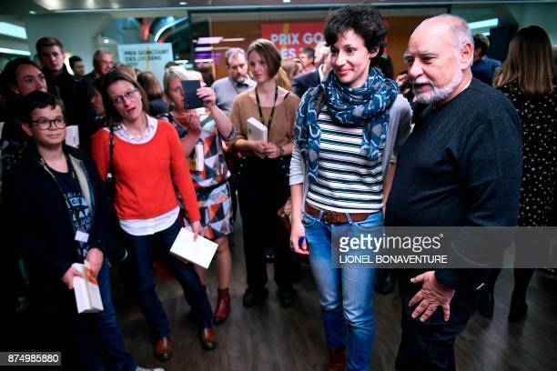 "French writer Alice Zeniter walks with French-Moroccan writer Tahar Ben Jelloun after being awarded the Prix Goncourt des Lyceens for her novel ""The..."