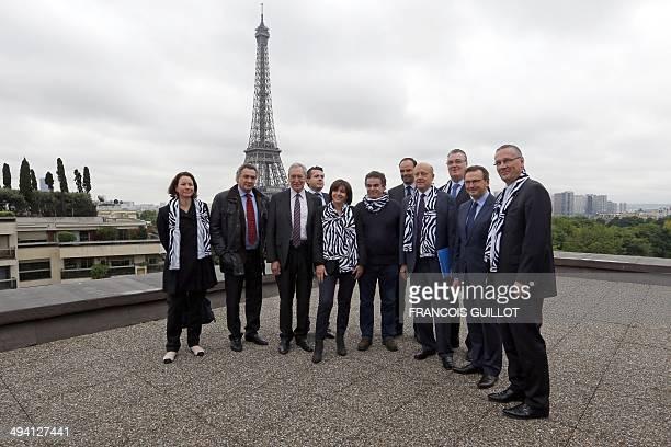 French writer and association Bleu Blanc Zebre cofounder Alexandre Jardin poses among Paris' mayor Anne Hidalgo Bordeaux's mayor Alain Juppe the...