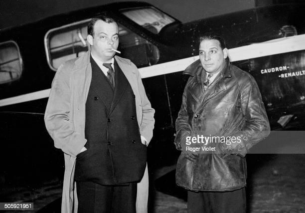 French writer and aviator Antoine de Saint Exupéry and mechanicnavigator André Prévot with their CaudronRenault aircraft at Le Bourget Airport Paris...